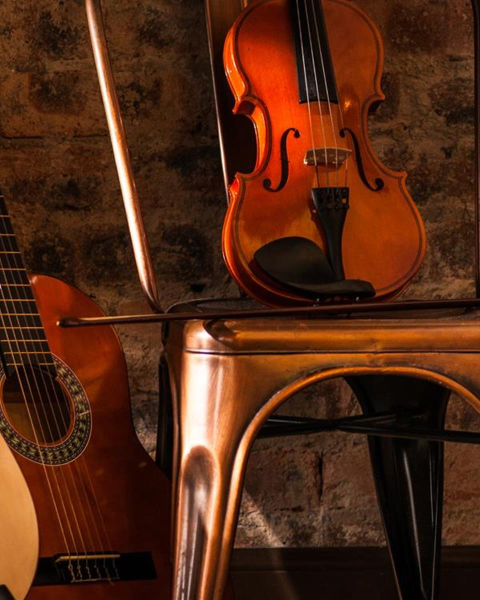 Musical Instruments & Fireplace at The Glencoe Inn