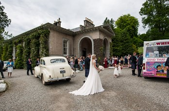 Couple & Wedding Car Outside Thainstone House