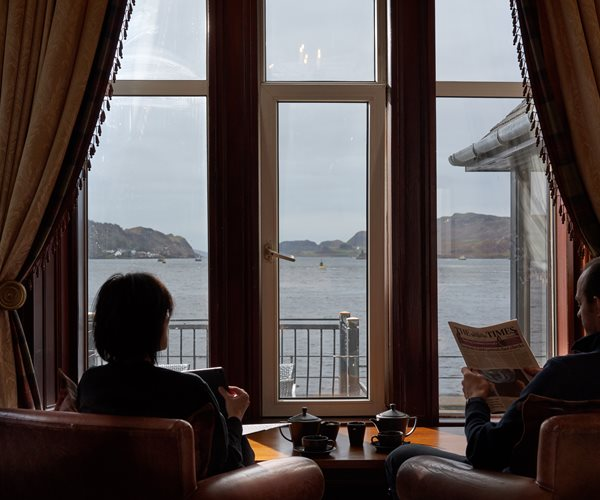 Couple Reading The Paper In The Sun Lounge At Oban Bay Hotel
