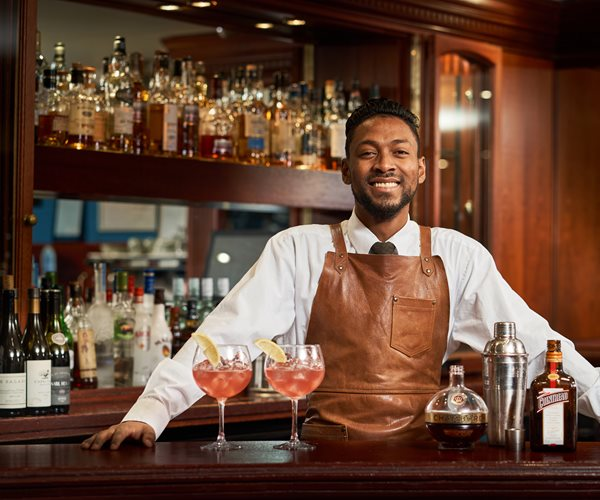 Barman Serving Cocktails At The Loch View Bar