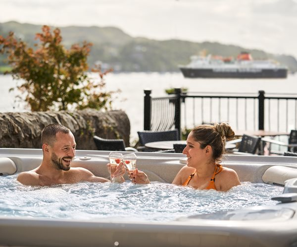 Couple in Outdoor Hot Tub at Oban Bay Hotel